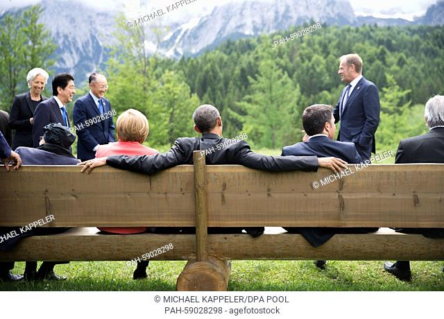 USpresident Barack Obama (C) sits on a bench next to German chancellor Angela Merkel and Italian prime minister Matteo Renzi surrounded by president of the...