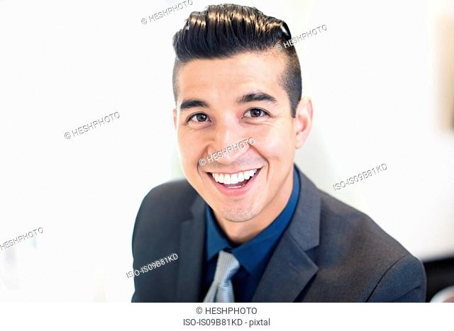 Portrait of smiling young businessman in office
