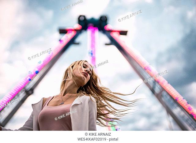 Long-haired young woman on a funfair