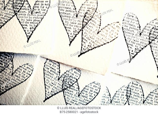 Multi image of rubber stamp hearts stamped in a pieces of paper
