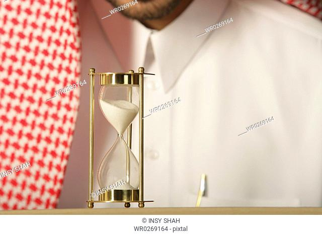 Arab Man with an Hourglass