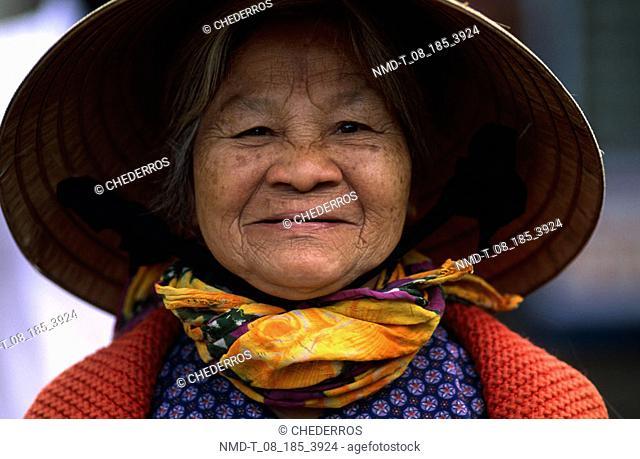 Portrait of a senior woman smiling, Vietnam