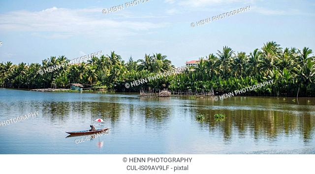 Fisherman on river at Hoi An, Quang Nam Province, Vietnam