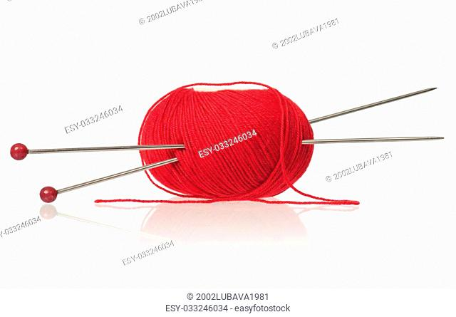 Red woolen yard with spokes over white background cutout