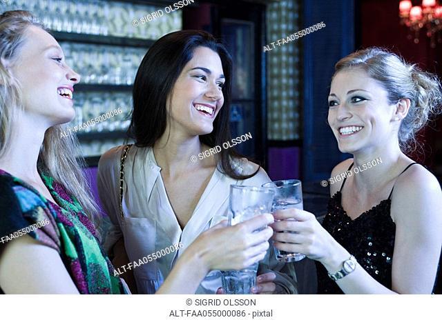 Friends celebrating together in bar