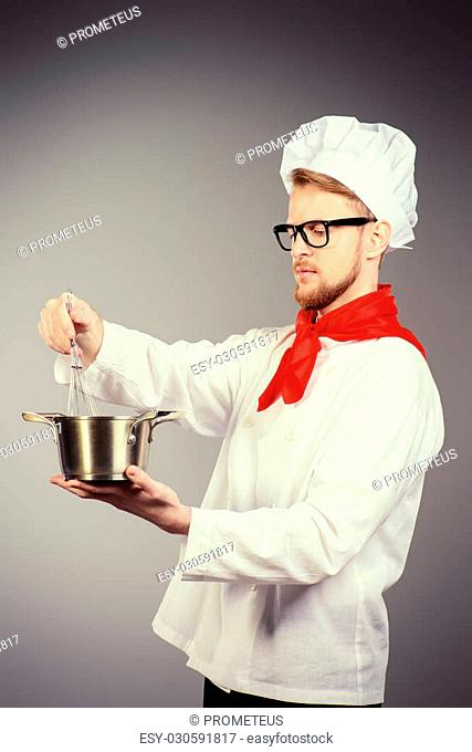 Chef tries cooked soup. Occupation. Studio shot