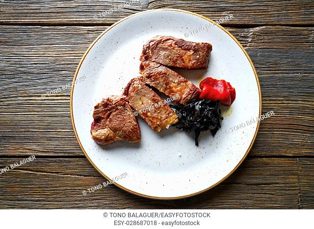 Grilled beef tenderloin with piquillo peppers and caramelized shallots