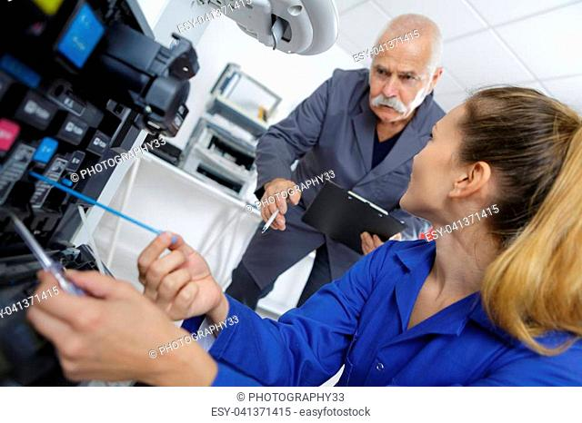 Technician working on photocopier