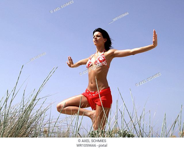 Young woman doing yoga exercises, Majorca, Spain, Europe