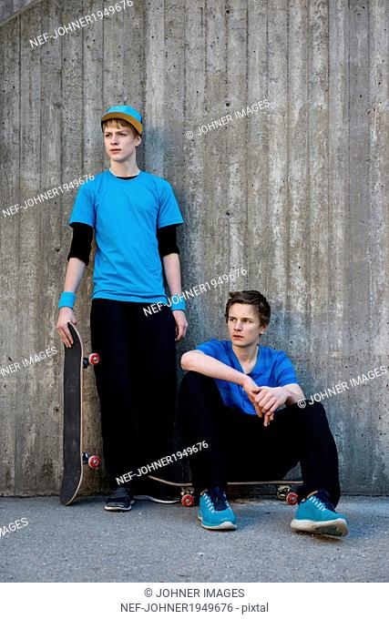 Two teenage boys against concrete wall, Stockholm, Sweden