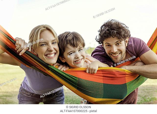 Family relaxing with hammock outdoors, portrait