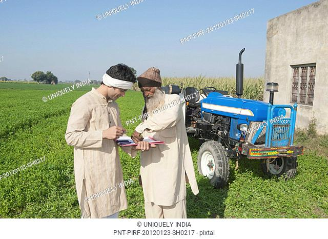 Farmer giving his thumbprint on the agreement of agriculture loan, Sonipat, Haryana, India
