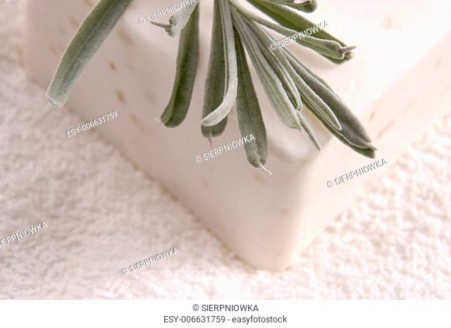aroma bath items. soap, fresh herbs (lavender) and towel
