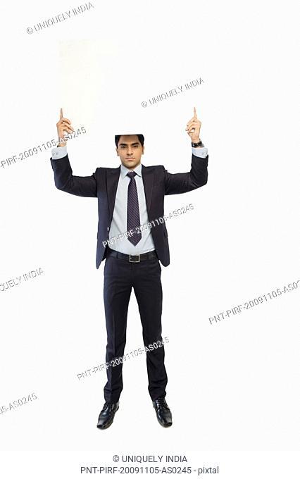 Portrait of a businessman showing a blank placard