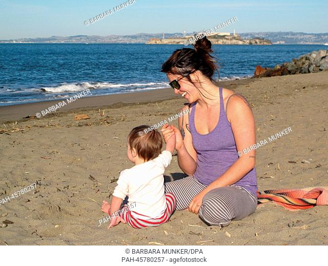The 24-years-old Californian Quinn Steckel sits together with her son Koda (11 months) on the Crissy Field beach in San Francisco, California