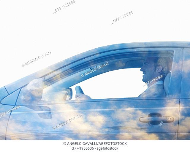 Man in a car with sky