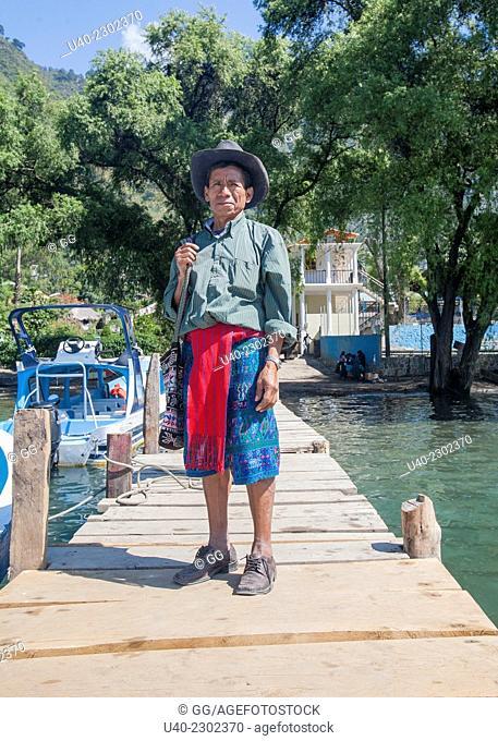 Guatemala, Mayan man standing on dock