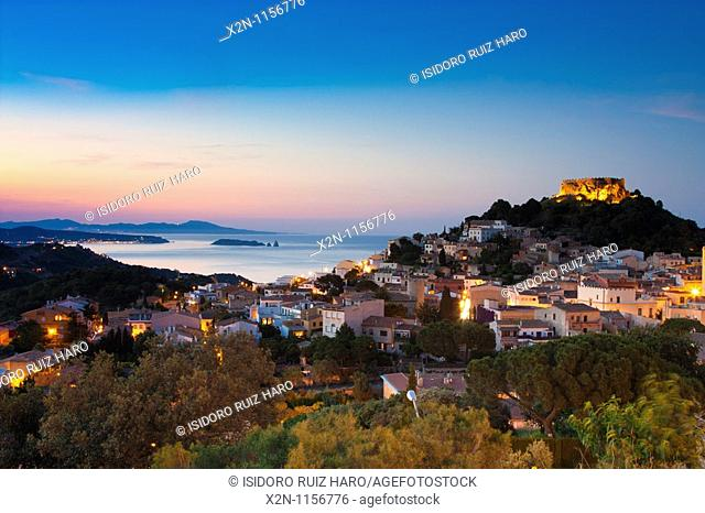 Begur village and castle at dusk with Medes Islands L'Estartit at the background Costa Brava Baix Empordà Catalunya Spain