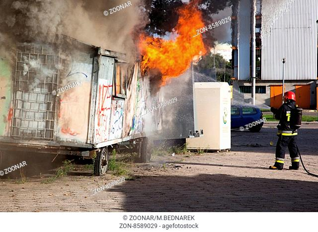 Gdansk, POLAND - AUGUST 14: Firefighters fighting a fire of a waste place, AUGUST 14, 2013 in Gdansk