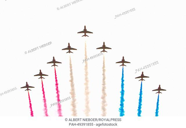 The Red Arrows, the Royal Air Force Aerobatic Team, fly during the Trooping of the Colour annual birthday parade in London, Britain, 14 June 2014