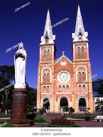 Low angle view of a statue in front of a cathedral, Notre Dame Cathedral, Ho Chi Minh City, Vietnam