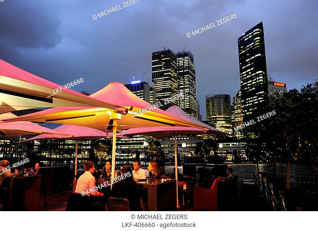 High rise buildings of the Central Business District, CBD, cafe terrace of the Cruise Bar at the Overseas Passenger Terminal in the evening, The Rocks