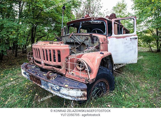 abandoned fire engine near former fish plant in Chernobyl Exclusion Zone, Ukraine