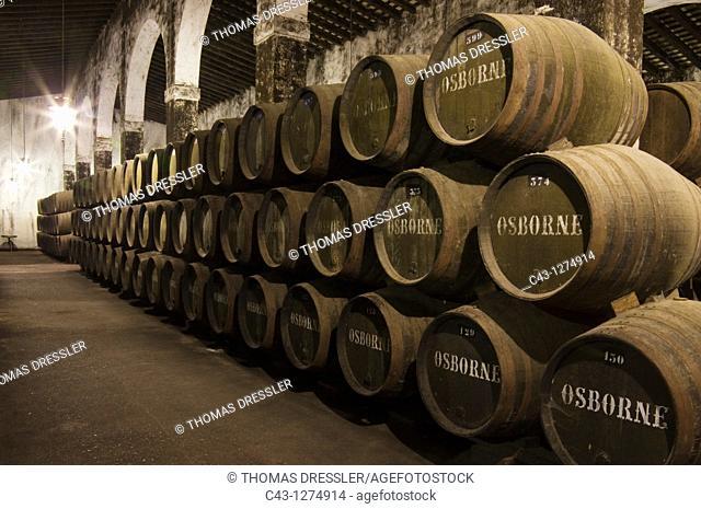 stacked oak barrels maturing red wine. Spain - Stacked Oak Barrels In One Of The Cellars At Bodega Osborne Maturing Red Wine