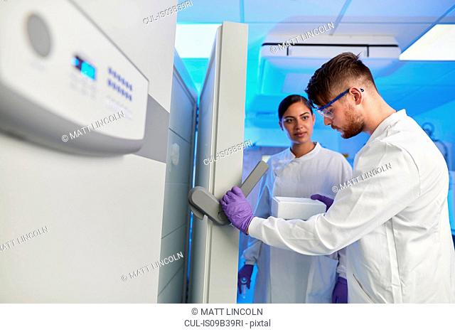 Scientists in laboratory using scientific equipment