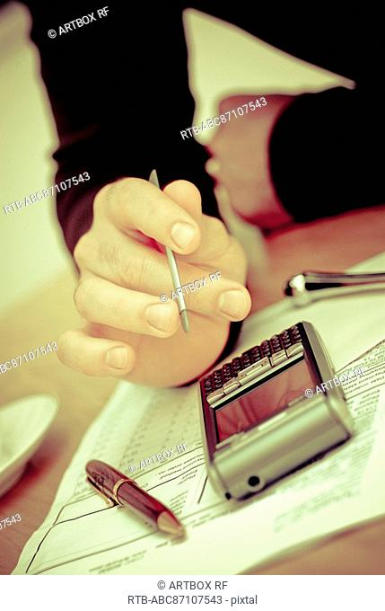 Close-up of a man's hand using a personal data assistant