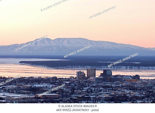 Aerial view of the downtown Anchorage skyline with Mt. Susitna Sleeping Lady and Cook Inlet in the background, Southcentral Alaska, Winter