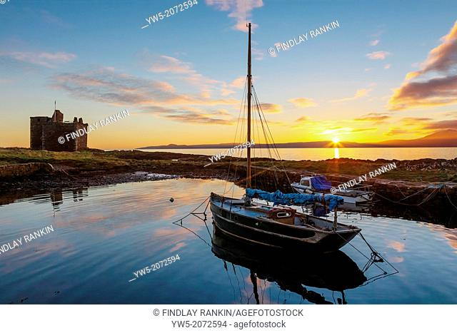 Sunset over the Isle of Arran, Firth of Clyde, Strathclyde, Scotland, UK, Great Britain, viewed from the harbour at Portencross