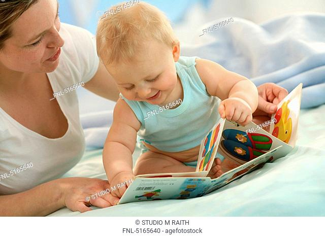 Mother and baby with picture book