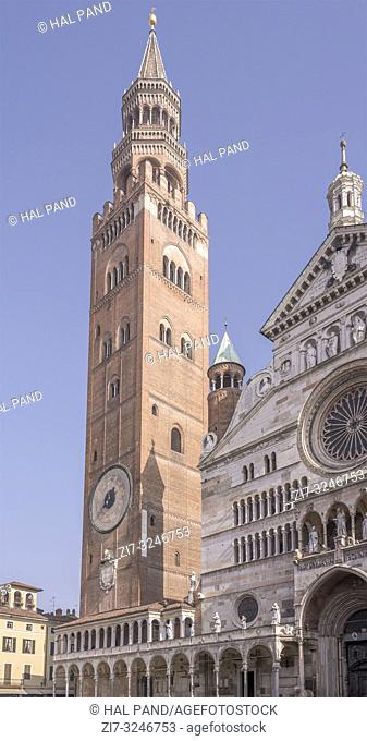 "view of Romanseque Cathedral huge bell tower called """"Torrazzo"""" , shot in bright winter light at Cremona, Lombardy, Italy"