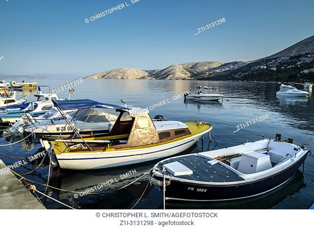 Small fishing boats on the old waterfront at Punat on the Croatian island of Krk