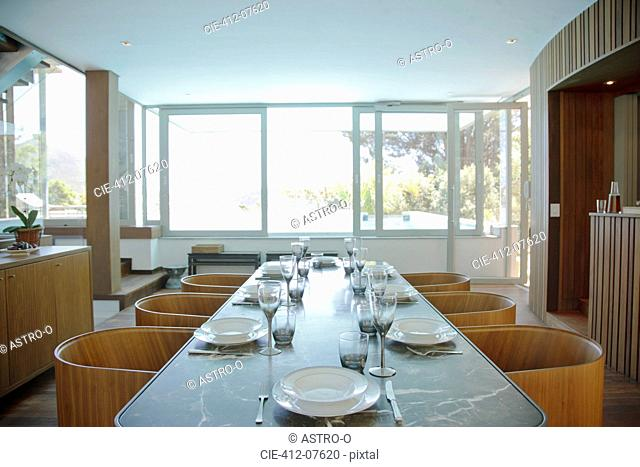 Place settings on table in luxury dining room