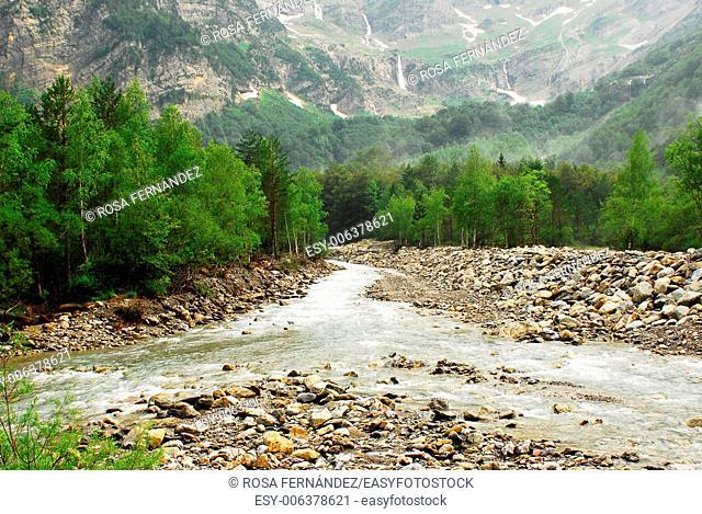 Cinca river, waterfalls and riparian wood with mist, Pineta valley, Ordesa and Monte Perdido National Park, Pyrenees Range, province of Huesca, Aragon, Spain