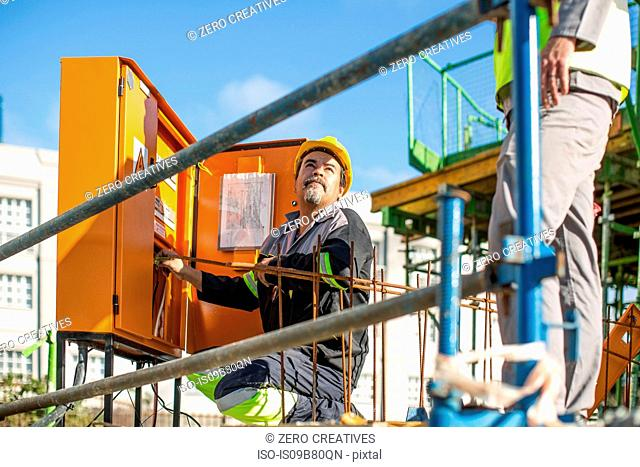 Construction worker checking machine