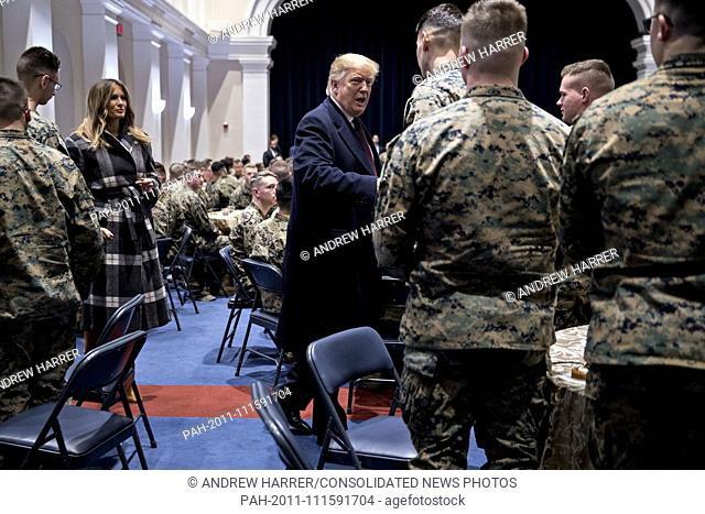 United States President Donald J. Trump, center, greets Marines with First Lady Melania Trump, left, while visiting Marine Barracks in Washington, D.C