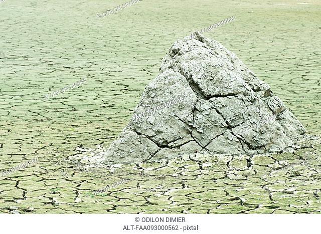 Dry, cracked earth in barren landscape