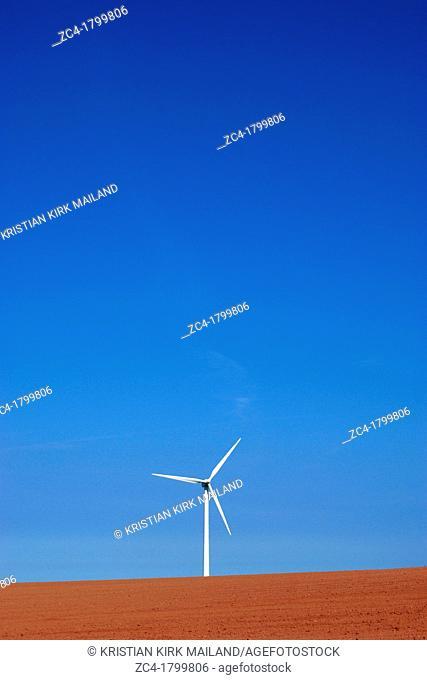 Wind turbine on colourful soil