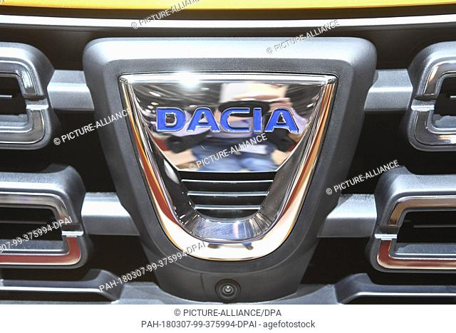 07 March 2018, Switzerland, Geneva: The logo of carmaker Dacia is displayed on the bonnet of an exhibited car during the 2nd Press Day at the 2018 Geneva Motor...