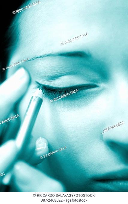 Woman making her eyelashes. . .