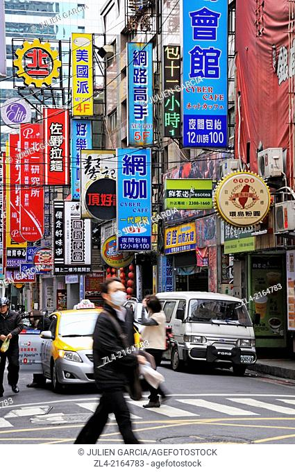 Street in the city center with many signboards. Taiwan (China), Taipei