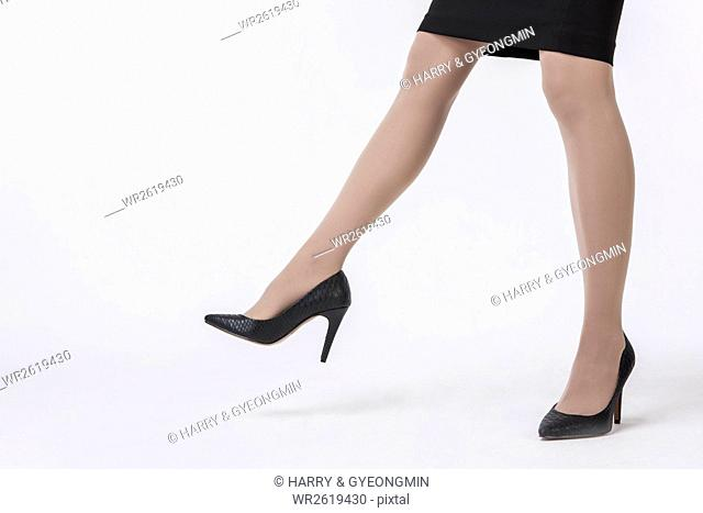 Businesswoman walking in highheeled shoes