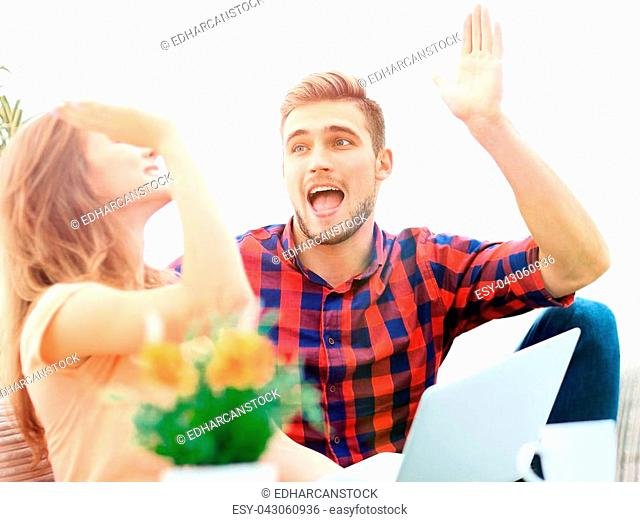 happy young couple giving each other a high five. the concept of success