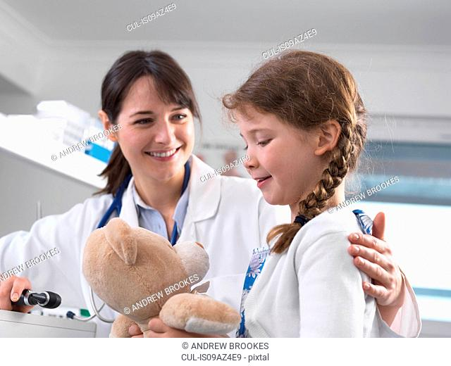 Pediatrician consulting with girl