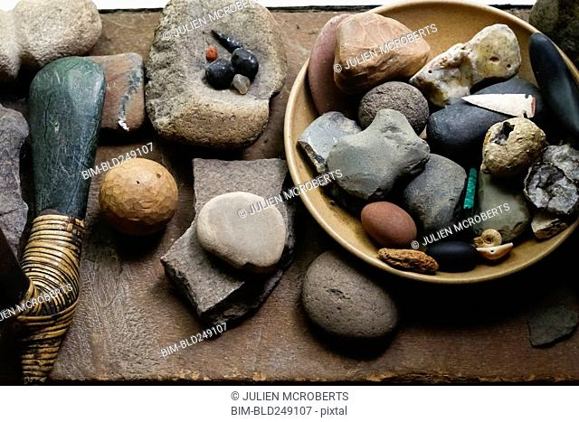 Stones in bowl and traditional tools