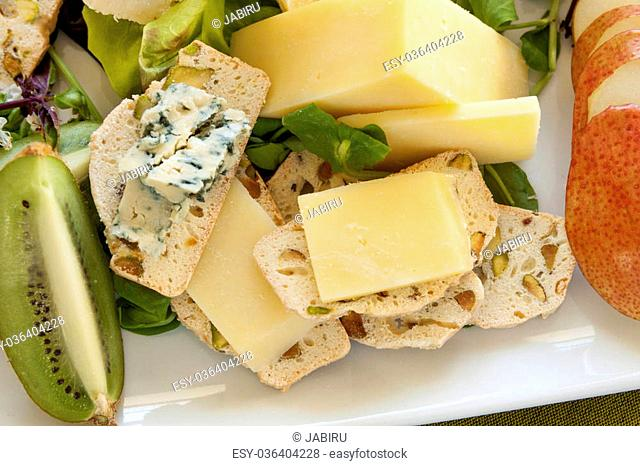 Delicious fruit and cheese platter featuring a variety of different cheeses and fresh fruits
