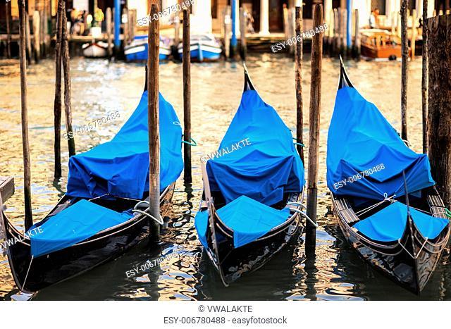 Three gondolas at sunset in Venice, Grand Canal, Italy